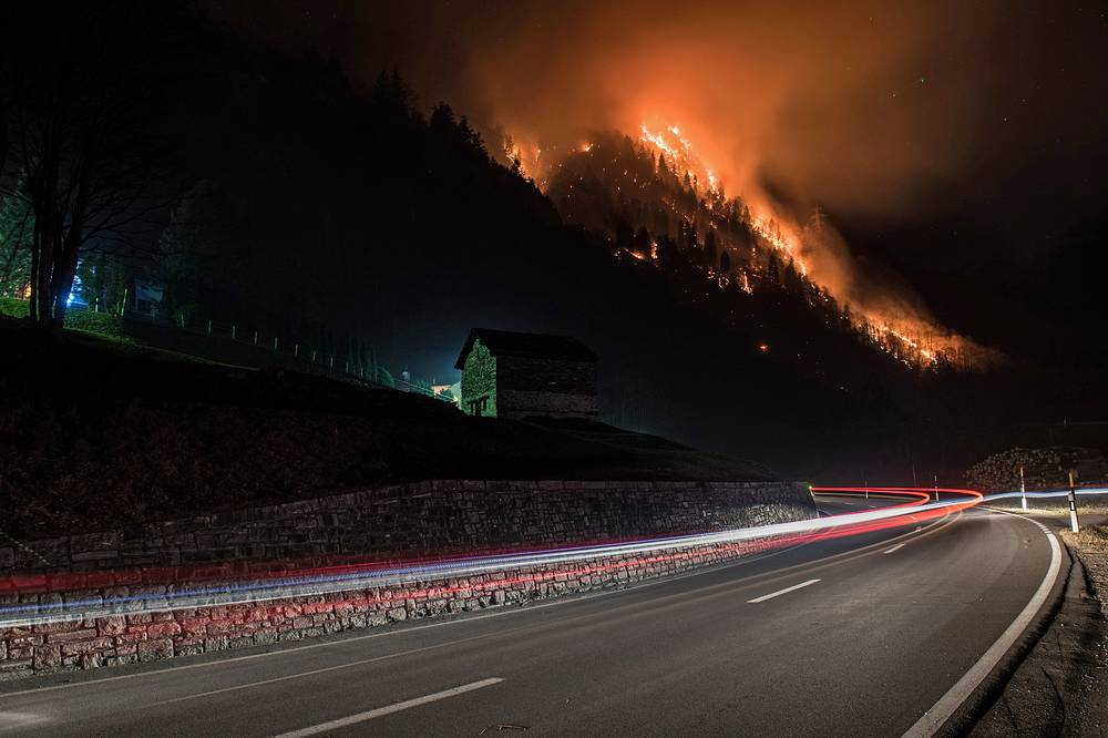 A forest fire burns in the Misox valley between Mesocco and Soazza, in the canton of Grisons, Switzerland, December 27