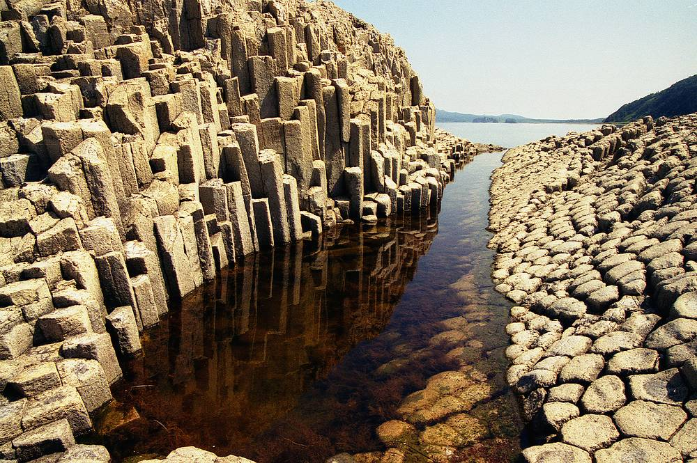 Cape Stolbchaty at east shore of Kunashir Island, famous for its columnar basalt formations, in Kurils Nature Reserve