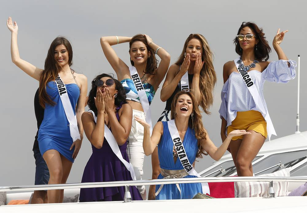 Miss Universe candidates from Portugal, Belize, Iceland, Curacao, the Bahamas and Costa Rica pose on a yacht during a visit to Philippine Navy headquarters in Manila, Philippines, January 19