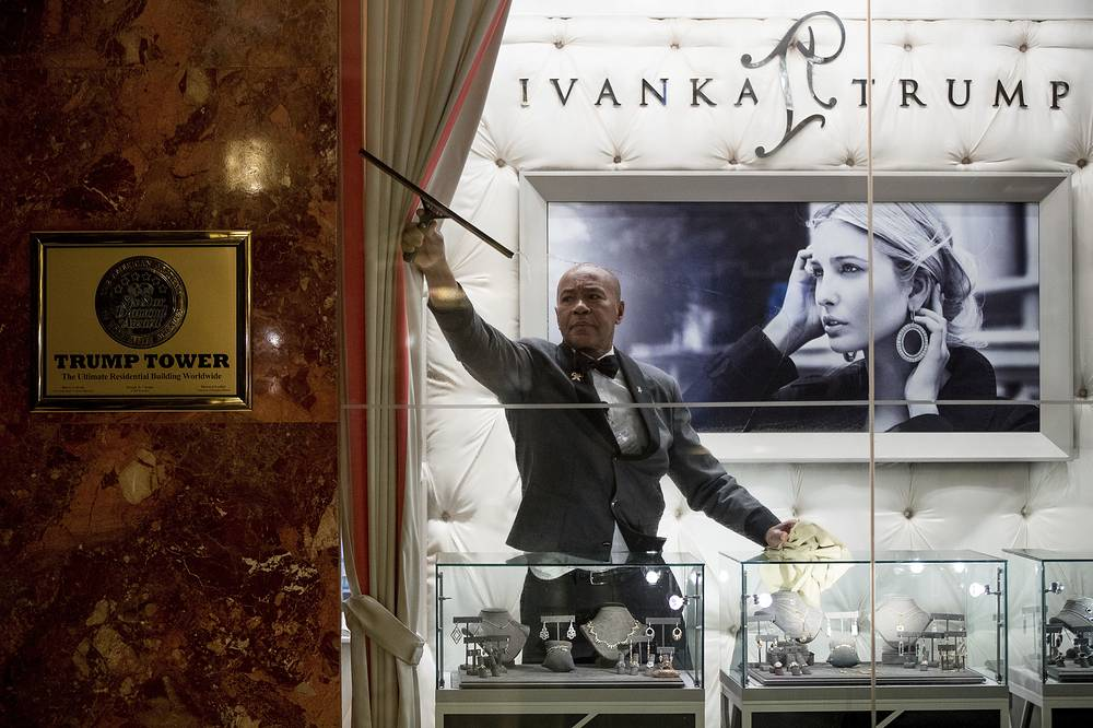 A worker cleans the windows of the Ivanka Trump Collection in the lobby of Trump Tower in New York, USA, January 17