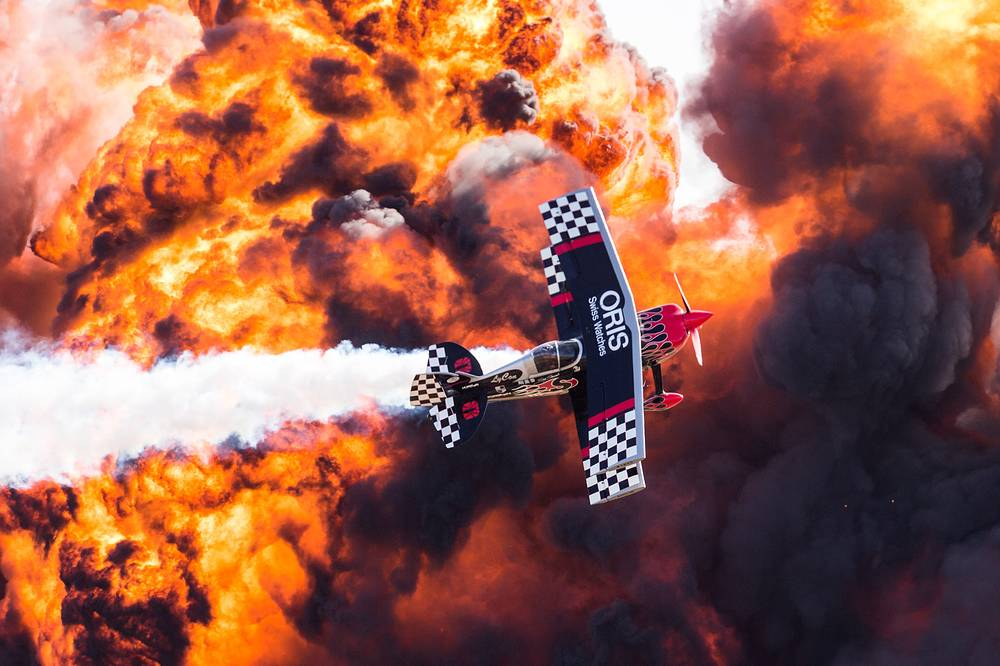 Oris TinStix of Dynamite aerobatic team flies past pyrotechnics wall of fire during the Australian International Airshow at Avalon Airport in Geelong, Australia, March 5