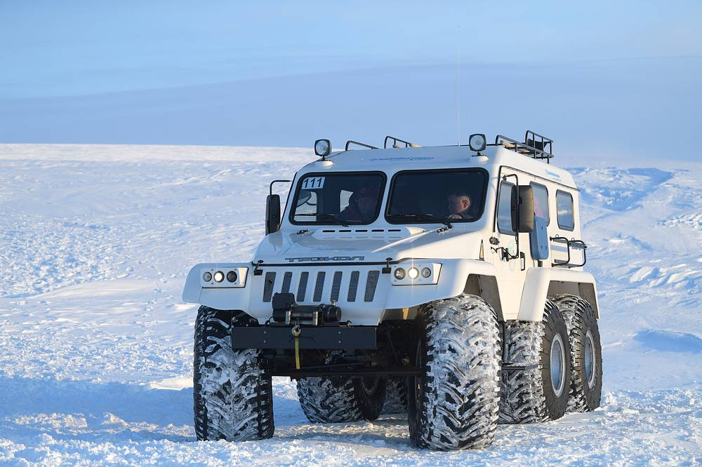 Vladimir Putin seen in an all-terrain vehicle at Severnaya Bay of Alexandra Land island