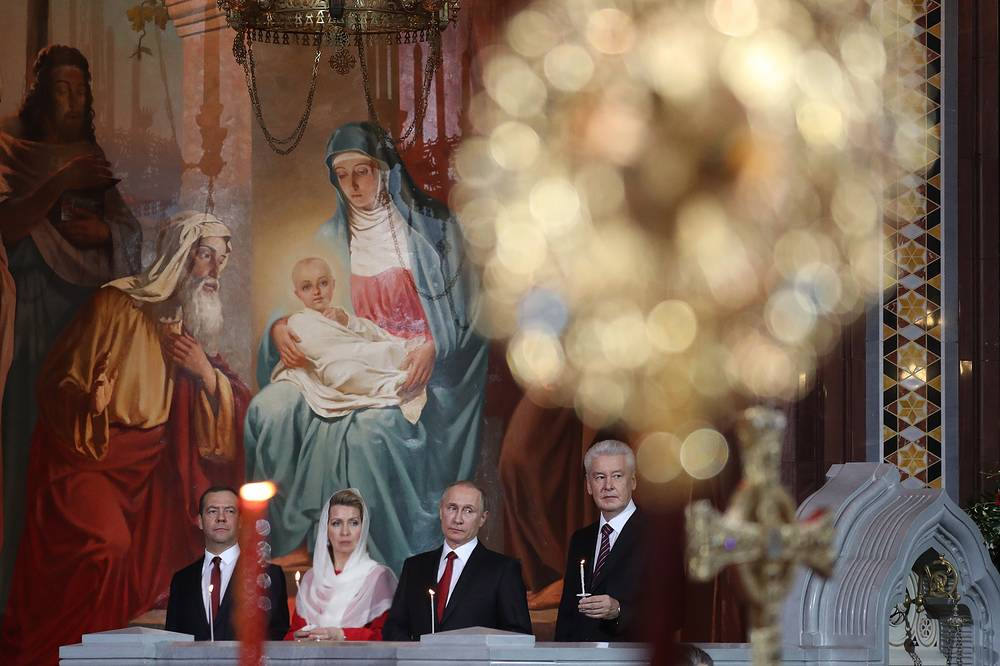 Russia's Prime Minister Dmitry Medvedev with his wife Svetlana, Russia's President Vladimir Putin and Moscow Mayor Sergei Sobyanin at the Easter service in Moscow, Russia, April 15