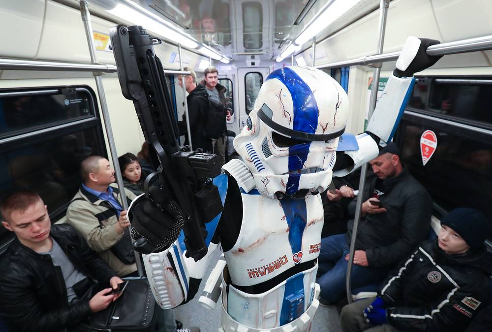 A man dressed as a stormtrooper participates in the 'Star Wars Day' flash mob in a train of the Moscow Metro, May 4