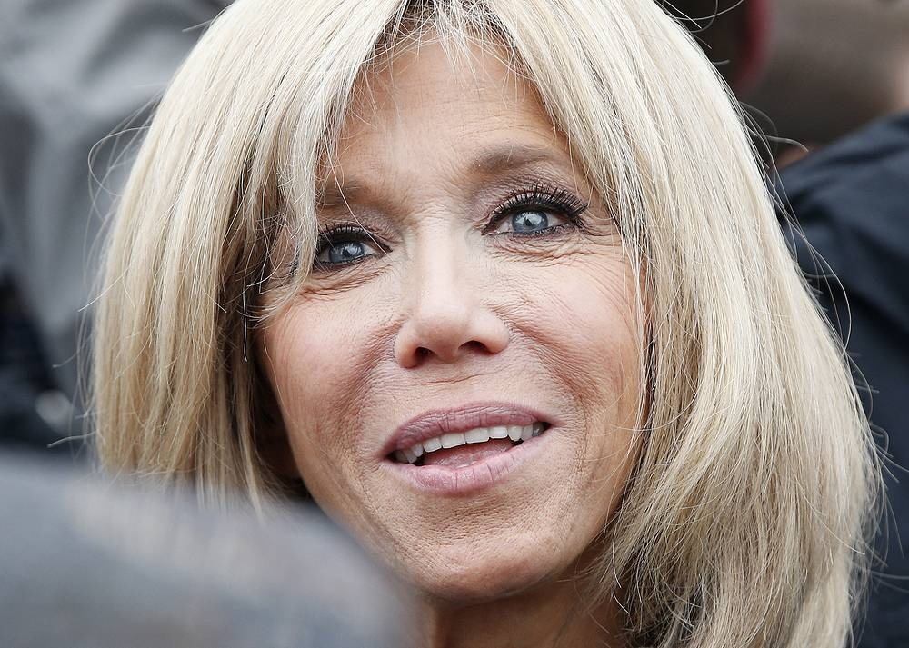 Brigitte Macron smiles after casting her vote in Le Touquet, France