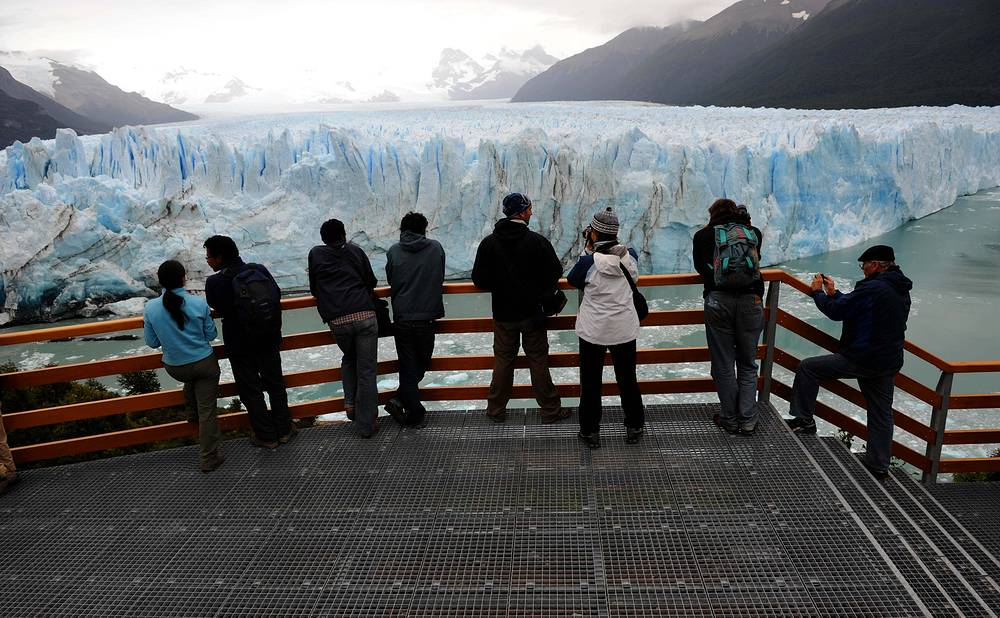 Visitors stand on a network of walkways beside the Perito Moreno Glacier