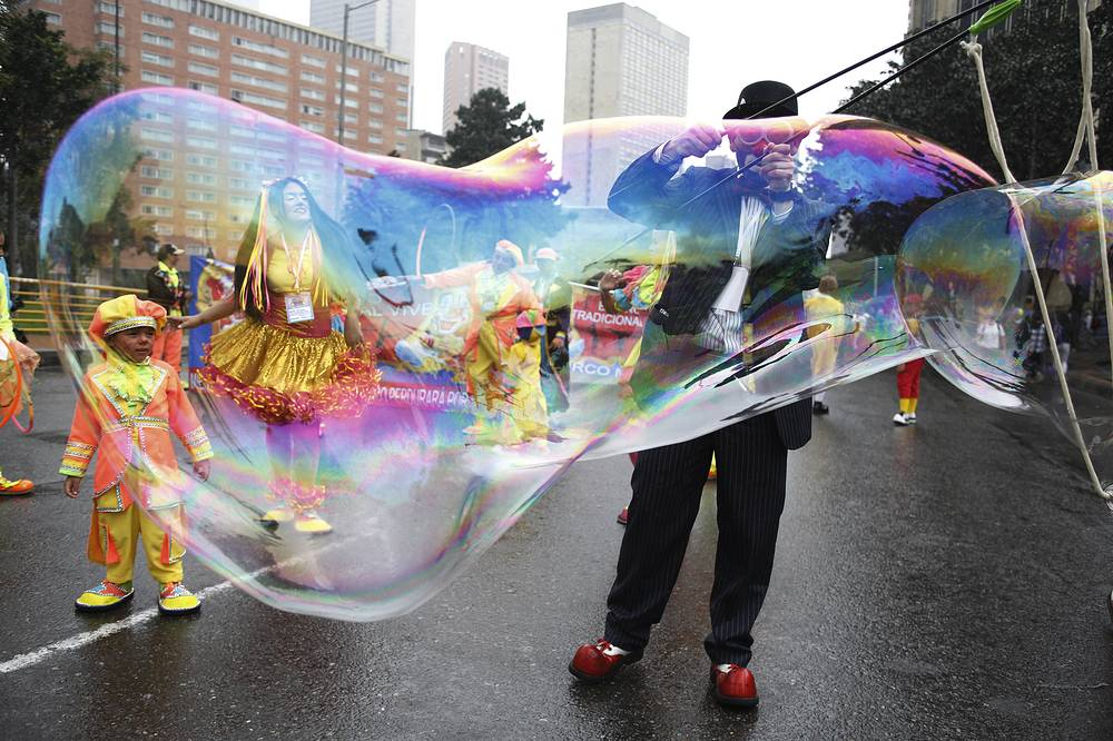 A clown creates a huge bubble during an anti-government protest in Bogota, Colombia,  May, 9