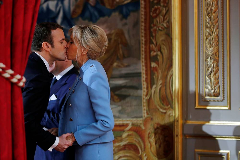 French President Emmanuel Macron kisses his wife Brigitte Trogneux during the inauguration ceremony in Paris, France, May 14