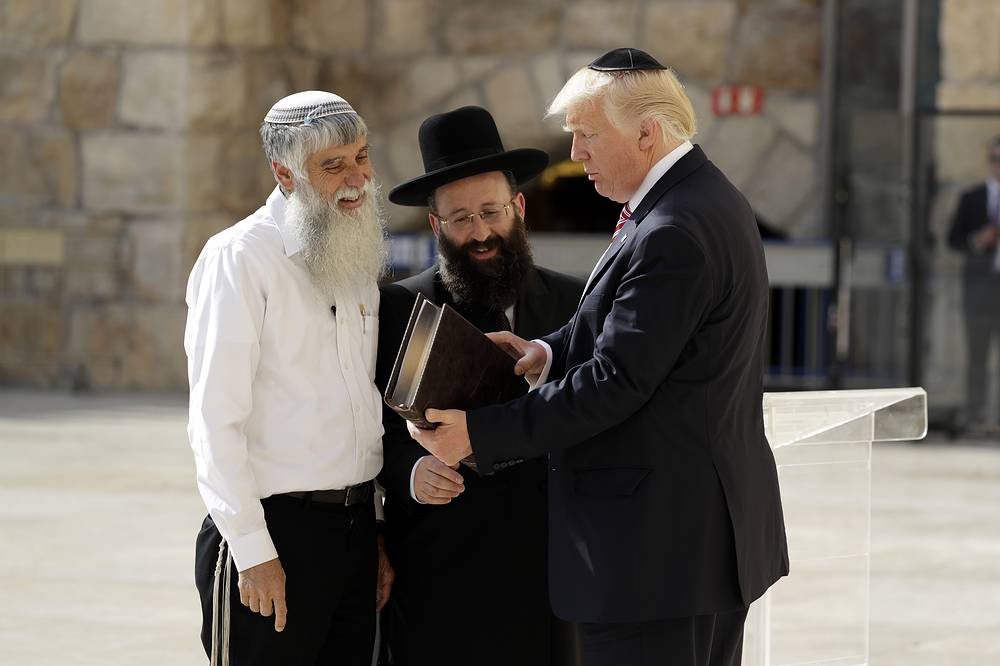 """US President Donald Trump, accompanied by Shmuel Rabinovitch, Rabbi of the Western Wall and Mordechai """"Suli"""" Elias, director general of the Western Wall Heritage Foundation, visits the Western Wall in Jerusalem"""