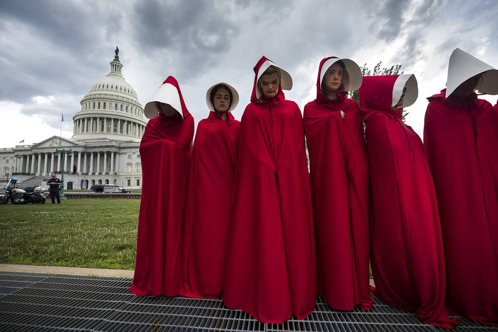 Supporters of Planned Parenthood dress in costumes from the dystopian novel The Handmaid's Tale to protest the Senate Republican's health care bill outside the US Capitol in Washington, USA, June 27
