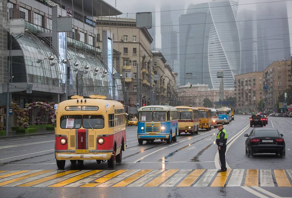 A parade of vintage buses marking Day of Public Transport in Moscow