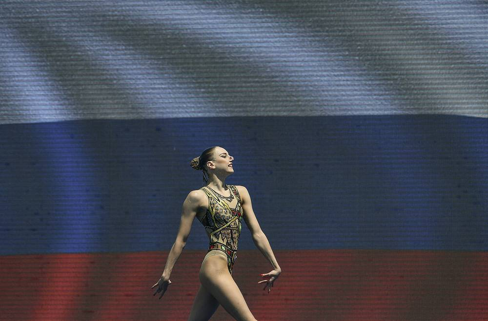 Gold medal winner, Svetlana Kolesnichenko, of Russia, performs in the women's synchronized swimming solo free final free routine