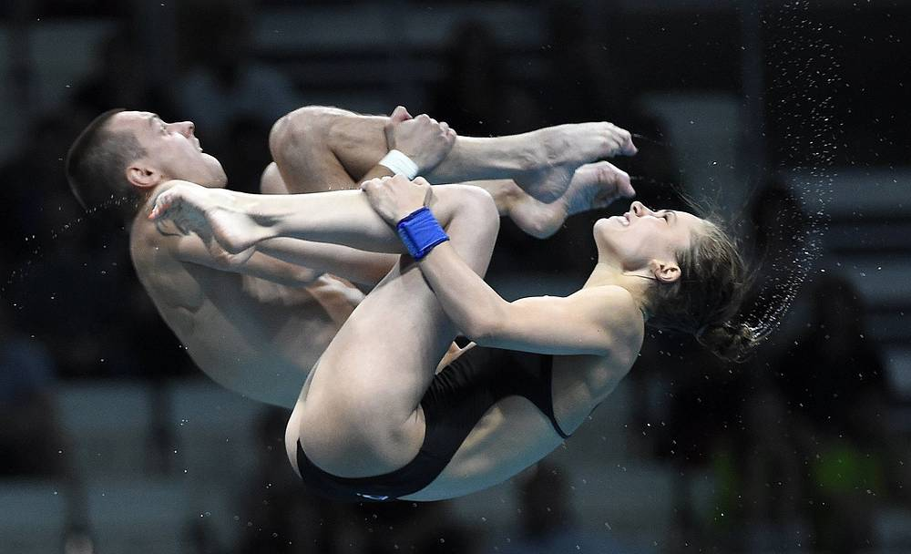 Iuliia Timoshinina and Viktor Minibaev of Russia compete in the mixed diving 10m synchro platform final