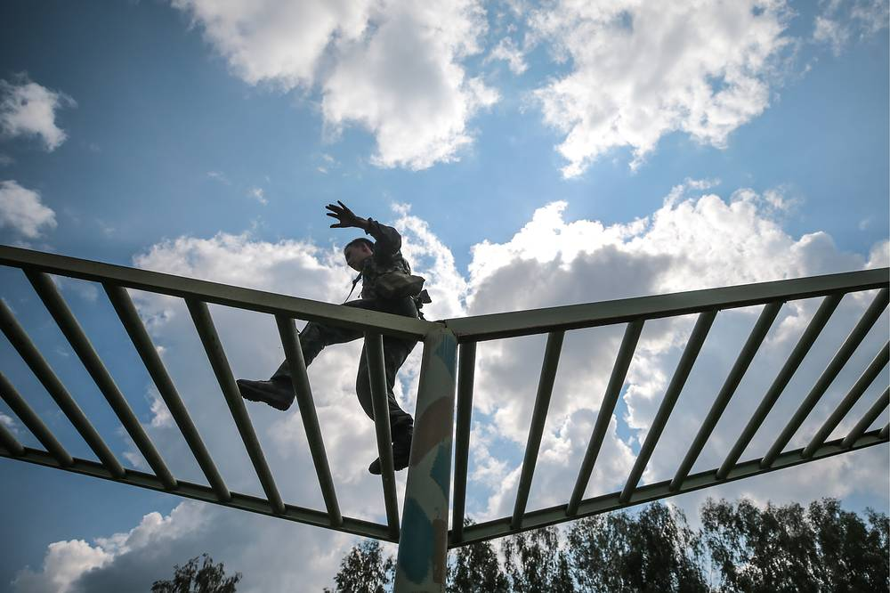 Kazakh serviceman taking part in the Scout Trail obstacle course