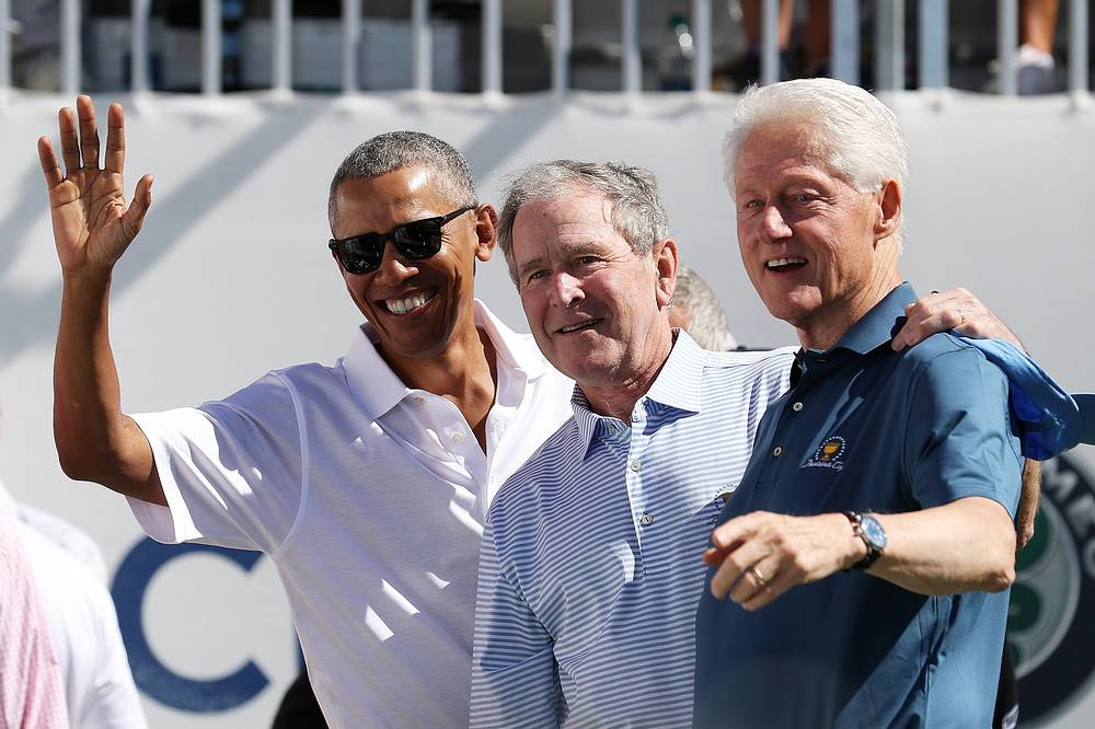 Former US Presidents Barack Obama, George W. Bush and Bill Clinton attend the trophy presentation prior to foursome matches of the Presidents Cup at Liberty National Golf Club in Jersey City, USA, September 28