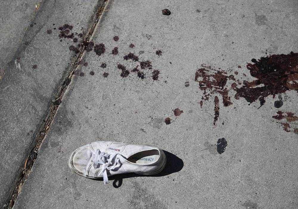 Blood stains and a discarded shoe lie in the street in the aftermath of the mass shooting at the Route 91 Harvest festival on Las Vegas Boulevard in Las Vegas, Nevada, USA, October 2