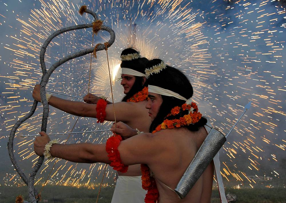 Artists dressed as Hindu gods Rama and Laxman act as fireworks explode during Vijaya Dashmi, or Dussehra festival celebrations in Chandigarh, India, September 30