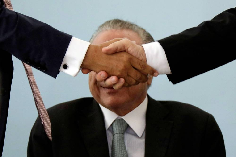 Brazil's President Michel Temer smiles during a ceremony in commemoration of the National Day of Micro and Small Enterprises, at the Planalto Palace in Brasilia, Brazil, October 4