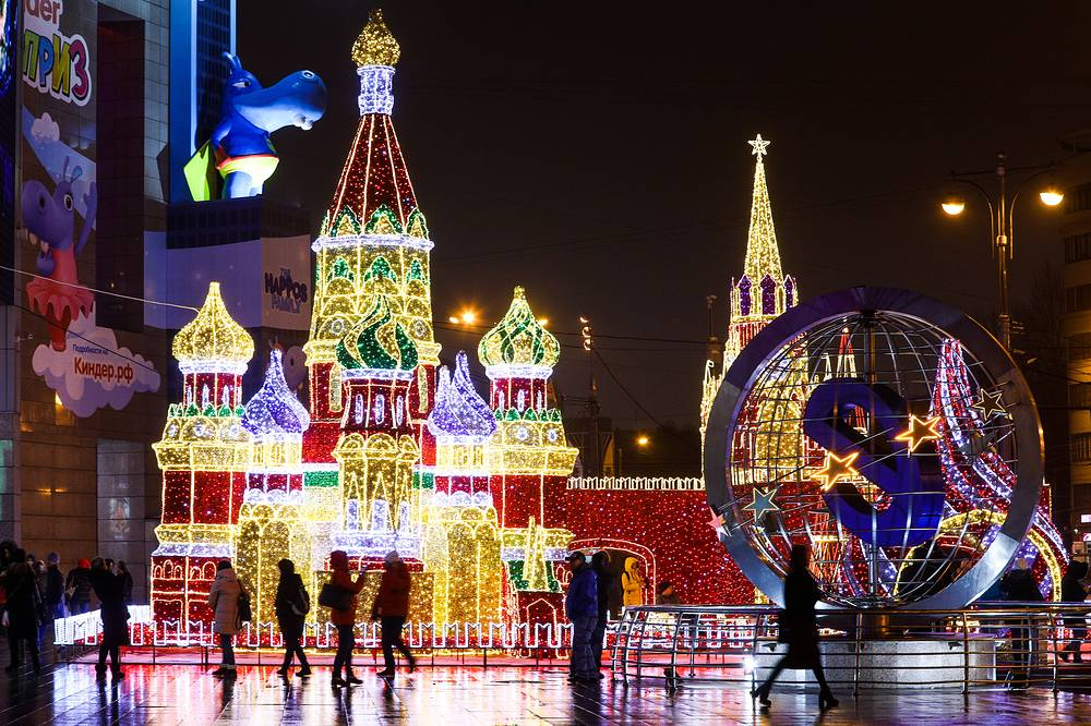 Moscow Kremlin's Spasskaya Tower and St Basil's Cathedral made out of Christmas lights in central Moscow
