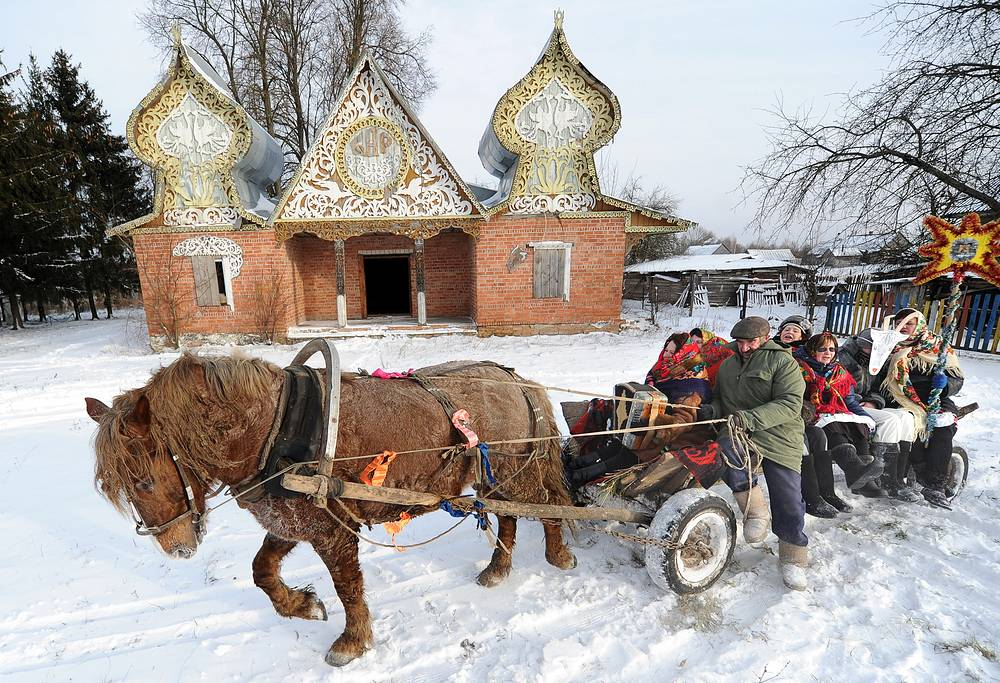 People participate in Christmas carolling  in the village of Storozhovtsy, Belarus