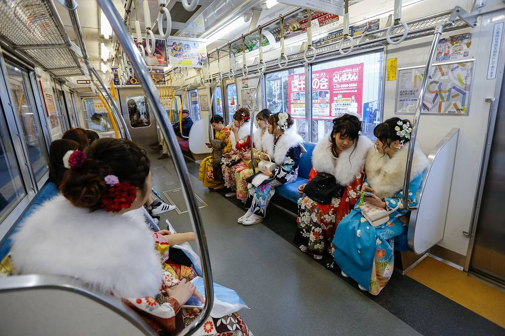 Young Japanese women dressed in colorful kimonos sit inside a train car after attending a ceremony marking the 'Coming of Age Day', a celebration for the youth who reach the age of 20 years old, at Toshimaen Amusement Park in Tokyo, Japan, January 8
