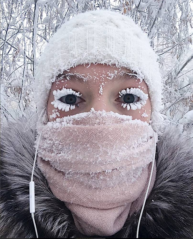 In this photo taken January 13, 2018, Anastasia Gruzdeva poses for selfie as the temperature dropped to about -50C (-58 degrees Fahrenheit) in Yakutsk, Russia