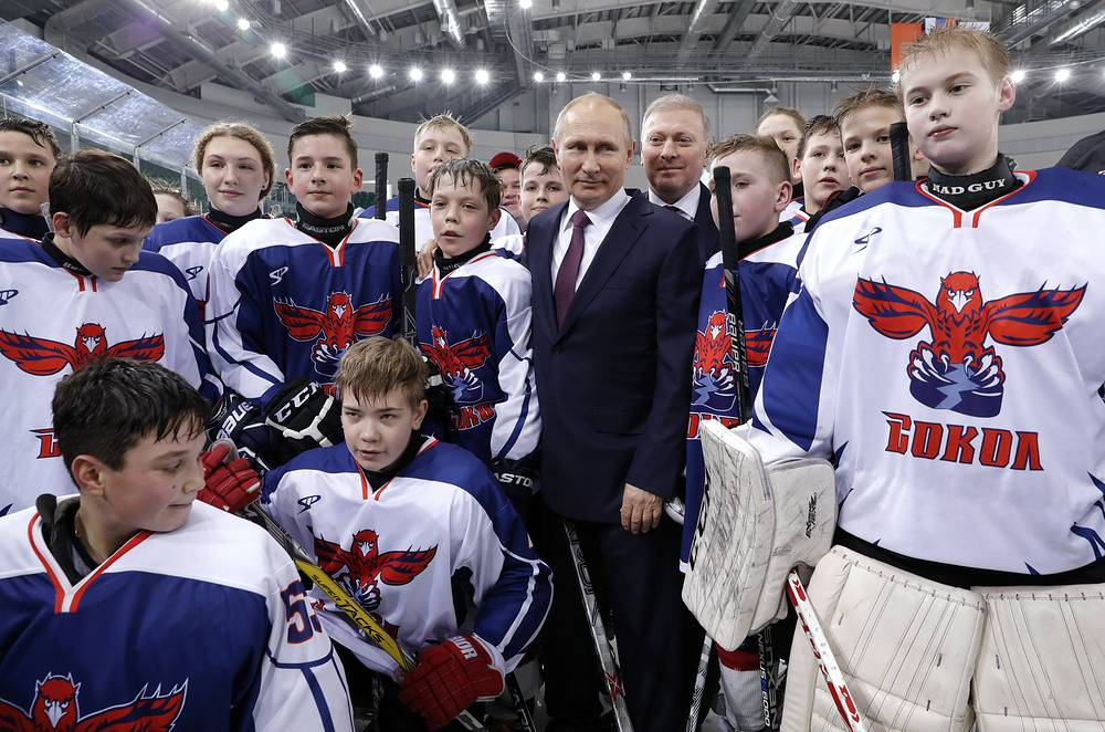 Russia's President Vladimir Putin pose for a photograph with members of the Sokol Krasnoyarsk junior ice hockey team at Platinum Arena Krasnoyarsk Sports and Entertainment Center, Russia, February 7