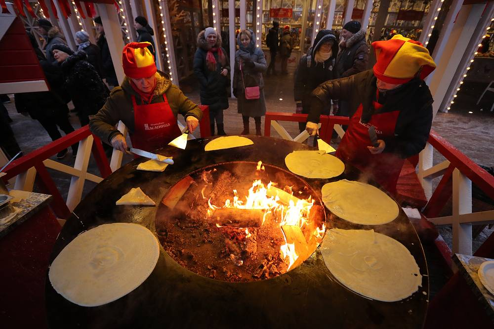 Making pancakes as part of Maslenitsa festival celebration marking the end of winter and welcoming the arrival of spring in Moscow