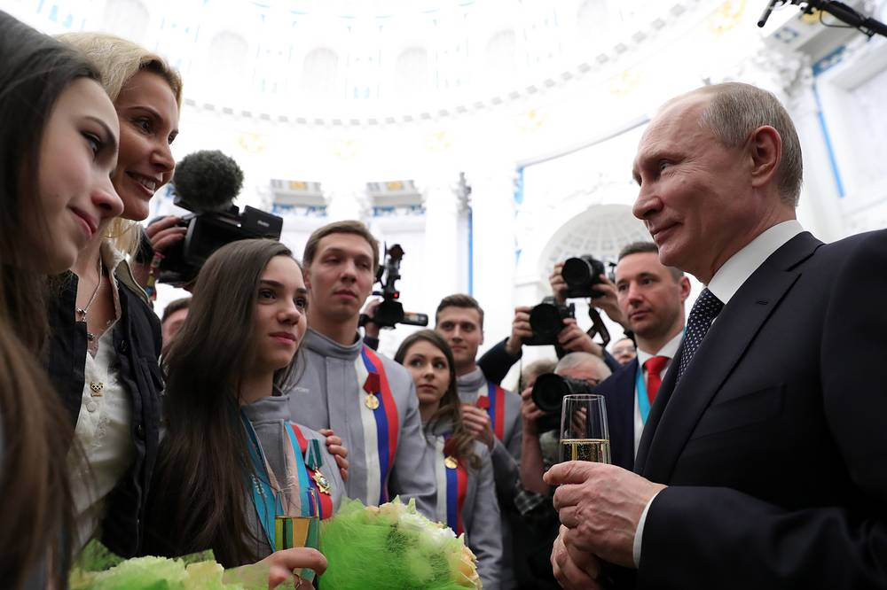 Figure skaters Alina Zagitova and Evgenia Medvedva, coach Eteri Tutberidze talk to Russia's President Vladimir Putin at a reception after a ceremony to present state decorations to Russian medallists of the PyeongChang 2018 Winter Olympics, at the Moscow Kremlin, Russia, February 28