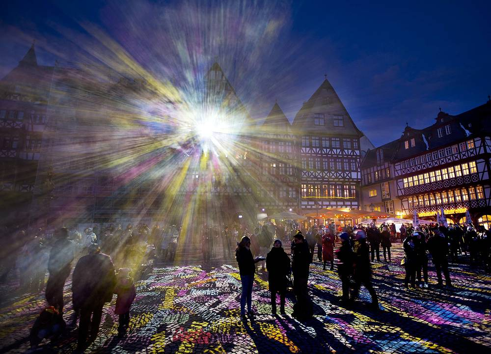 """Light shines out from one of the buildings at Roemer Square during the official opening of the """"Luminale"""" light festival in Frankfurt, Germany, March 20"""