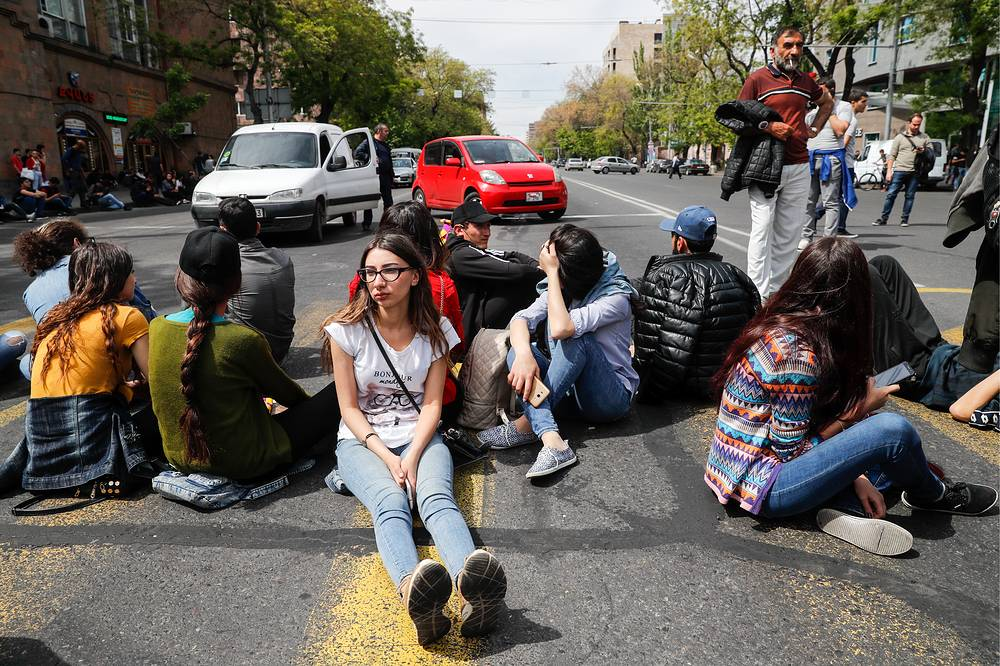 People take part in a mass protest against the election of former President Sargsyan as Prime Minister in Yerevan
