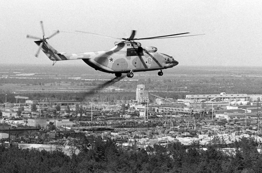 A helicopter sprays a decontaminate over the region surrounding the Chernobyl nuclear power station