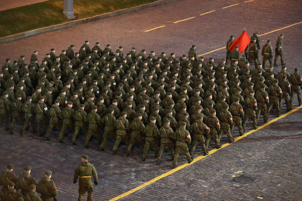Servicemen seen in Moscow's Red Square during a night rehearsal of a Victory Day military parade