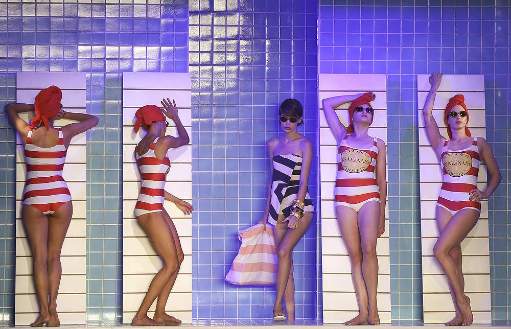 Models pretend to rest on chairs as they stand in creations from the Salinas collection during Sao Paulo Fashion Week in Sao Paulo, April 25