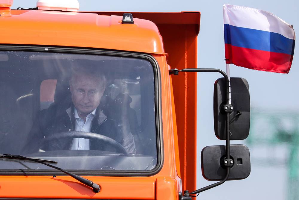 Russia's President Vladimir Putin behind the wheel of the lead vehicle, a Kamaz truck, during a passage of construction machines on the Kerch Strait (Crimean) Bridge