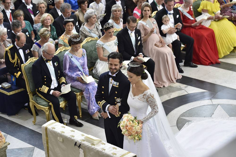 Swedish Prince Carl Philip and Sofia Hellqvist listen during the wedding ceremony in the Royal Palace chapel in Stockholm, Sweden, June 13 2015