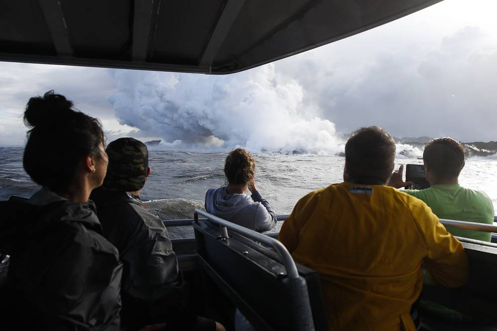 The eruption of Kilauea volcano sparked new safety warnings about toxic gas on the Big Island's southern coastline after lava began flowing into the ocean and setting off a chemical reaction
