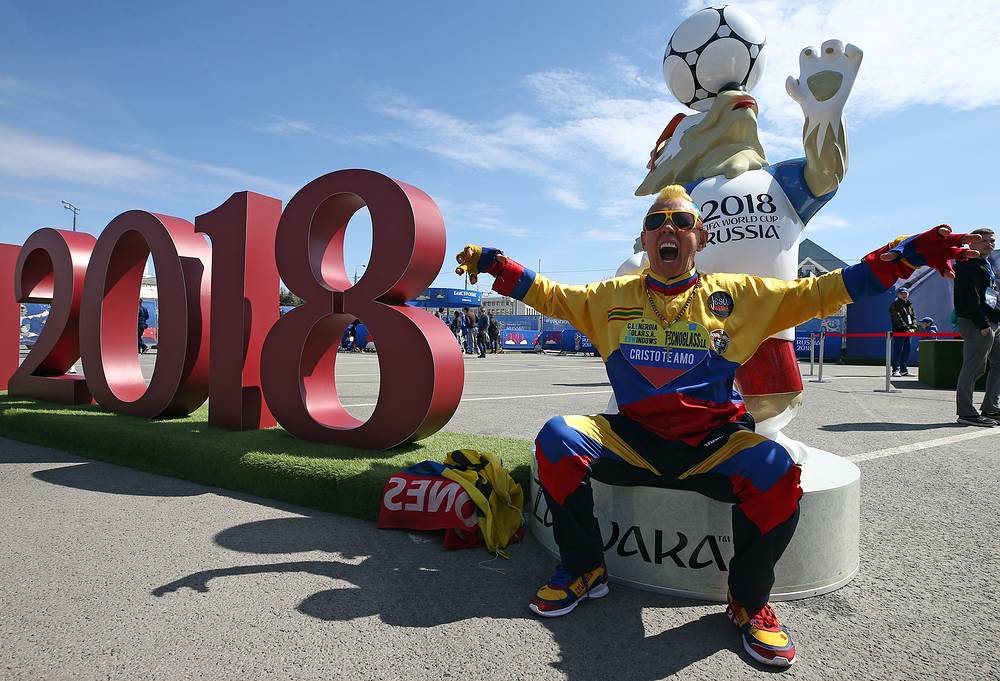 Gustavo Llanos (also known as 'El Cole'), a legendary fan of Columbia's national football team, seen by a figure of Wolf Zabivaka, the official mascot of the 2018 FIFA World Cup, in 2018 FIFA World Cup Football Park in Kazan