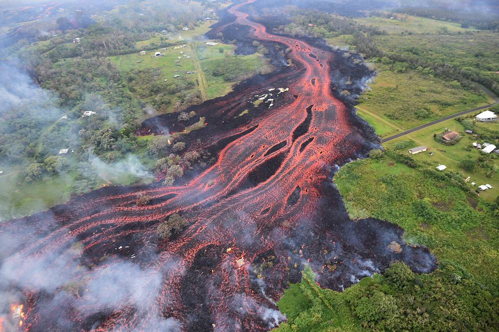 Lava flows from fissures near Pahoa, as eruption of Kilauea volcano continues in Hawaii, May 19