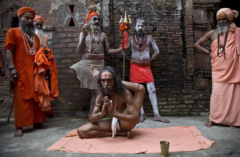 An Indian Hindu Naga Sadhu performs yoga as part of the 4th International Day of Yoga during the annual Ambubachi festival in Kamakhya temple in Guwahati, June 21
