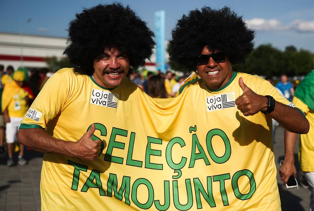 Supporters of Team Brazil show thumbs up outside Spartak Stadium in Moscow