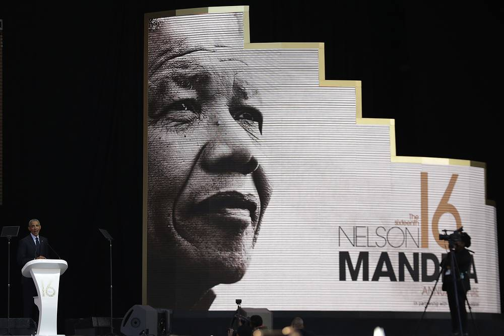 Former US President Barack Obama delivers his speech during an address marking the 100th anniversary of anti-apartheid leader Nelson Mandela's birth at the Wanderers Stadium in Johannesburg, South Africa