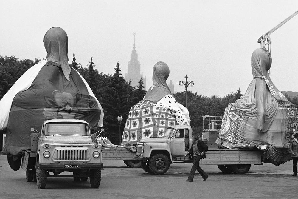 A Soviet truck line delivering huge wrap-covered typical Soviet puppets to the Lenin stadium in Moscow, July 15, 1980