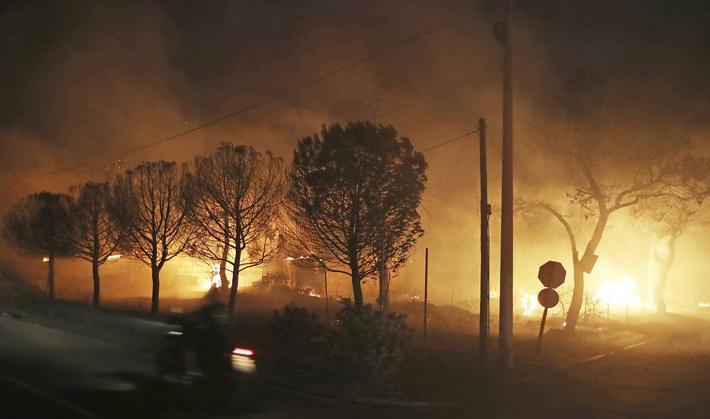 Buildings burn in the town of Mati, east of Athens, July 23