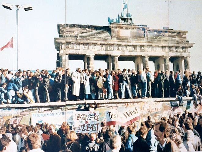 Germans stand on top of the Wall in the days before it was torn down, 1989