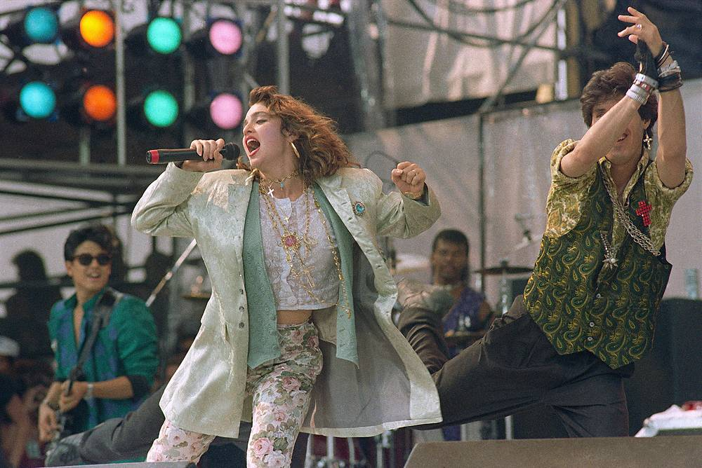 Madonna performing onstage during Live Aid famine relief concert at JFK Stadium,1985