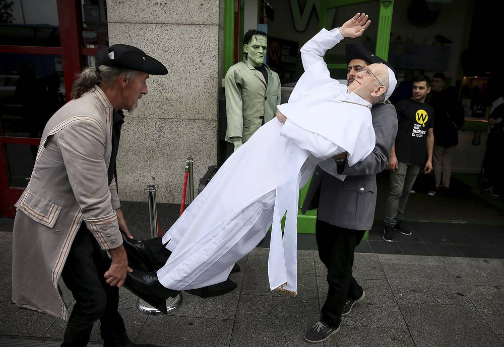 A newly unveiled wax work of Pope Francis is carried at the National Wax Museum Plus ahead of Pope Francis' visit to Ireland, in Dublin, August 23