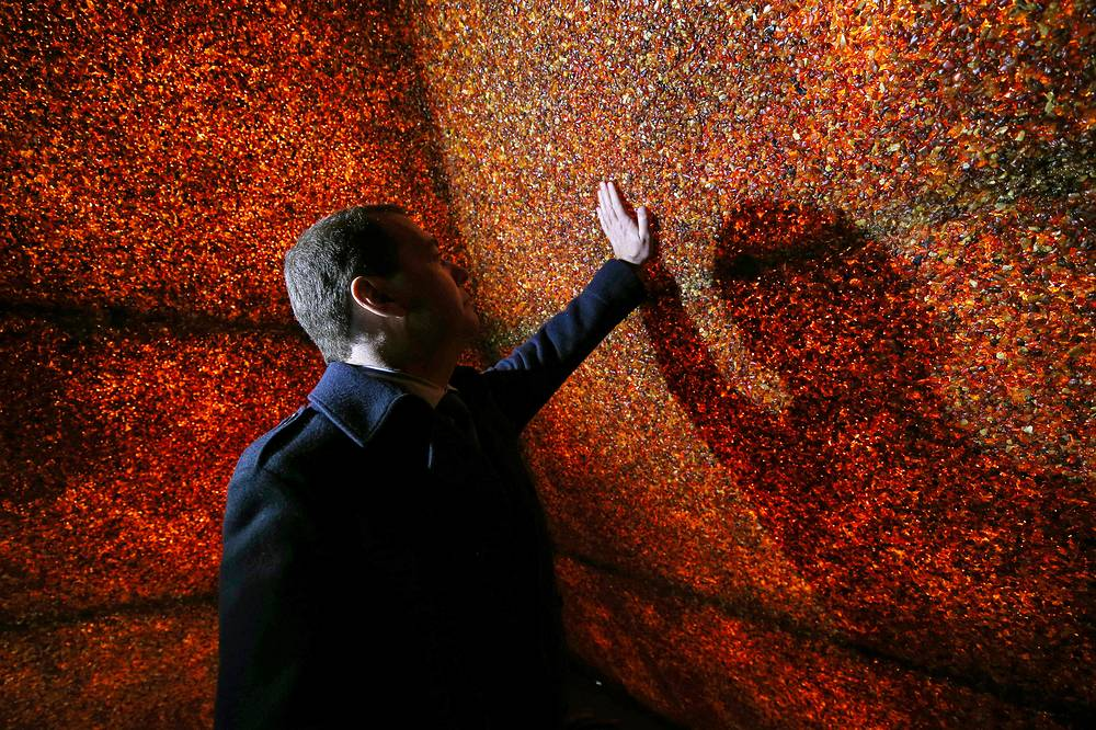 Russia's Prime Minister Dmitry Medvedev visits an amber pyramid in the village of Yantarny, October 23