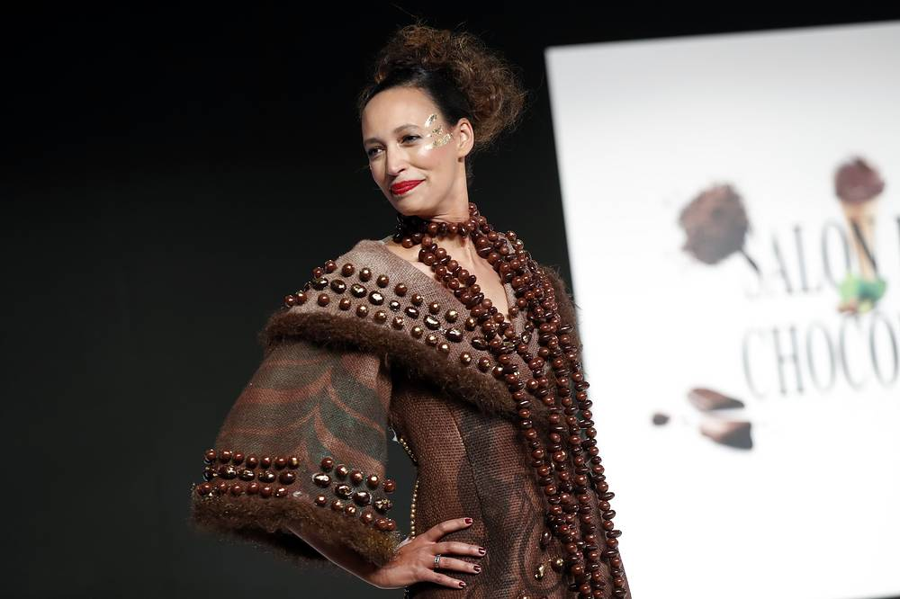 A model presents a chocolate studded dress during a show as part of the chocolate fair in Paris