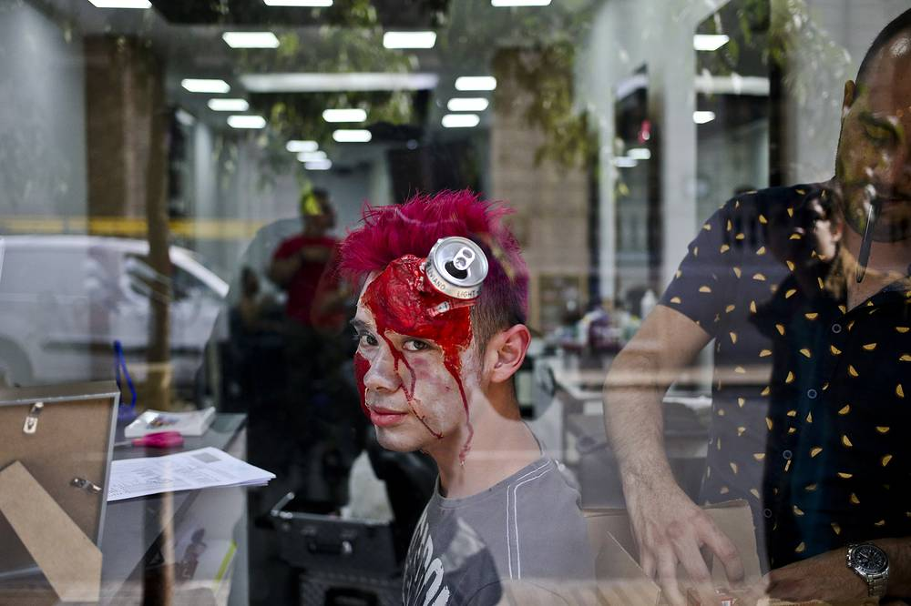 A worker of the beauty salon is preparing gets ready to celebrate Halloween in Santiago, Chile